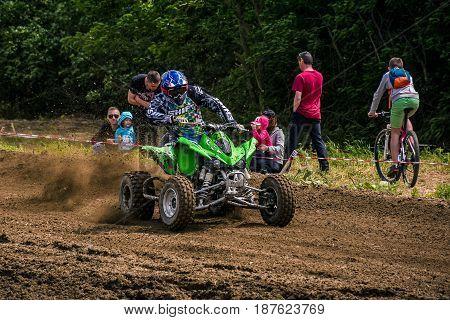 Atv Rider Accelerating In Dirt Track.