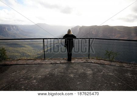 A girl standing at Evan's Lookout in the Blue Mountains, New South Wales, Australia.