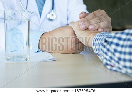 Male Doctor Holding Patient's Hand, Comforting Patient Who Is In Ambulance,  Helping Concept