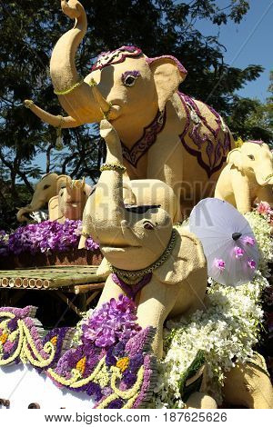 Scenery from statues and flowers on the street Thailand south east asia