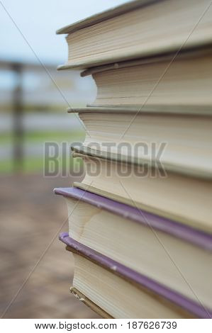Stack old book extreme closeup. Selective focus vertical composition