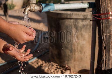 Close up Asian children wash hands .