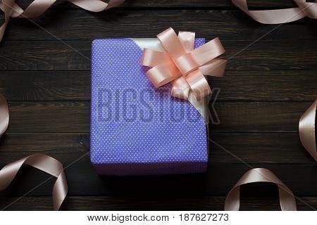 Gift box on a dark wooden background