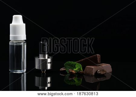 Aroma of chocolate and mint for refueling an electronic cigarette concept with reflection on a black background
