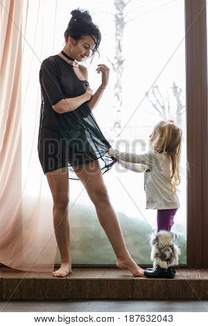 Mom In Black Dress And Little Girl