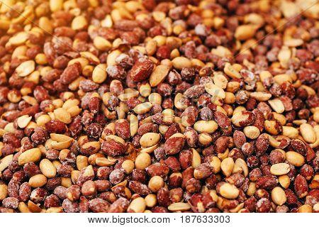 Pile of salted peanuts on street market selective focus