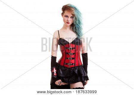 BDSM model in leather corset isolated on white background in studio photo