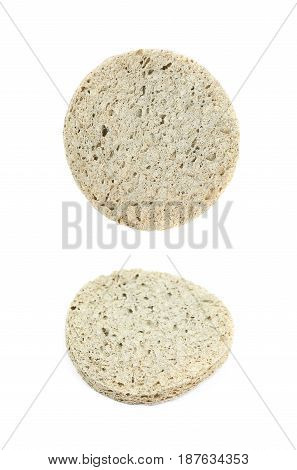 Used make-up face cleaning round sponge isolated over the white background, set of two different foreshortenings