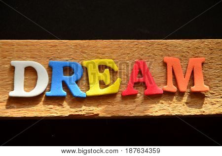 word dream on a  abstract colorful, background,