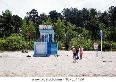 Jurmala, Latvia - May 20, 2017: Rescue station with solar panels on the roof. Lifeguard watches the beach