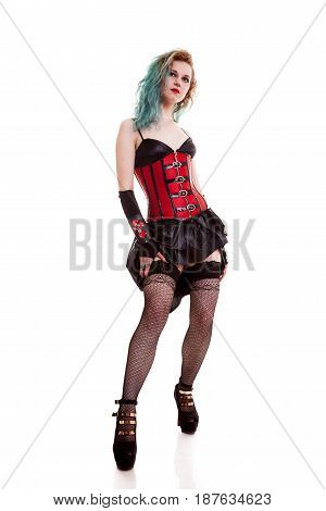 Sensual BDSM model in leather corset isolated on white background in studio photo