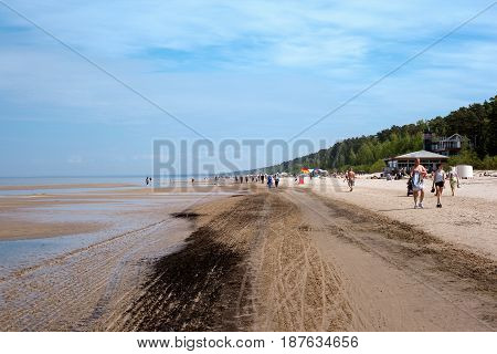 Jurmala, Latvia - May 20, 2017: People at the Baltic sea in Jurmala, Latvia recreational resort