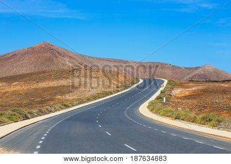 Empty Road On Blue Sky Background, Lanzarote, Spain