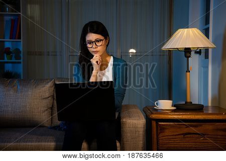 Woman Working Late At Night In The Work Place