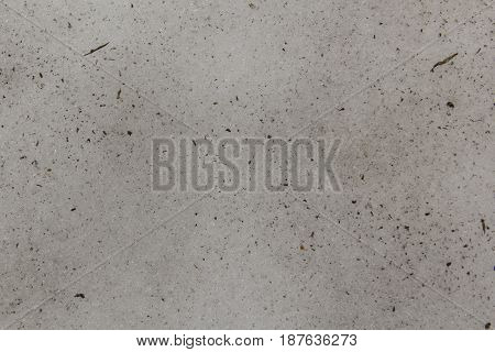 Background of dirty spring snow with splashes of black