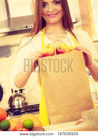 Woman Housewife In Kitchen With Many Fruits