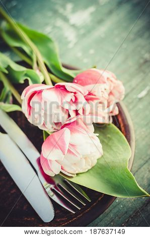Festive Table Setting With Pink Tulips. Holiday Table Set for Mother's Day or Birthday. Selective Focus.