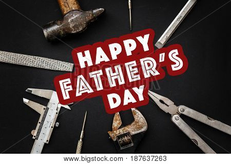 Happy Father's Day Text Sign On Working Tools Hammer Wrench Pliers Calipers Screwdriver Chisel On Bl