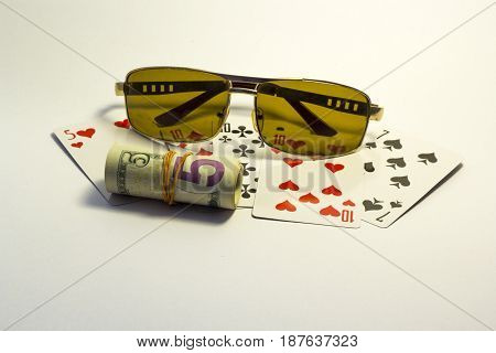 Several cards on a white background with sunglasses and dollars