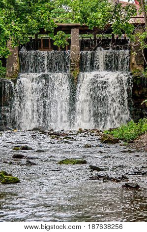 Aleksupite artificially modified waterfall at the old mill
