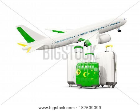 Luggage With Flag Of Cocos Islands. Three Bags With Airplane