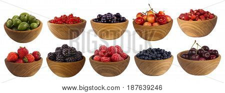 different berries isolated on white background. Collage of fruits and berries: blueberry blackberries cherry strawberry currant and raspberry. Collection of fruits and berries in a bowl.