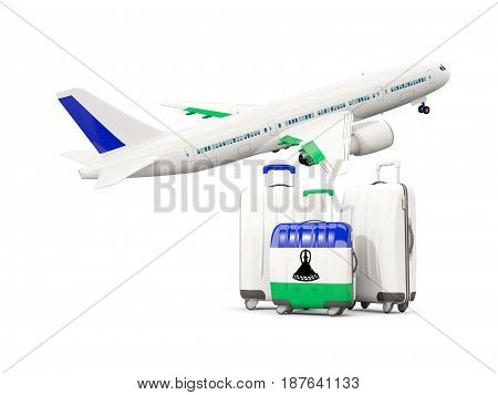 Luggage With Flag Of Lesotho. Three Bags With Airplane