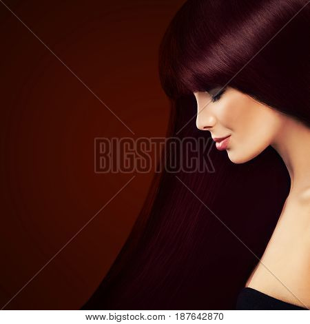 Healthy Hair and Hair Coloring Concept. Beautiful Woman with Long Red Hair on Background