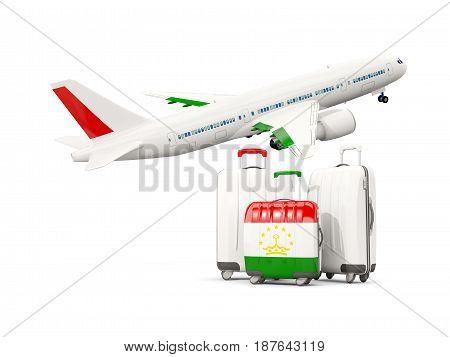 Luggage With Flag Of Tajikistan. Three Bags With Airplane
