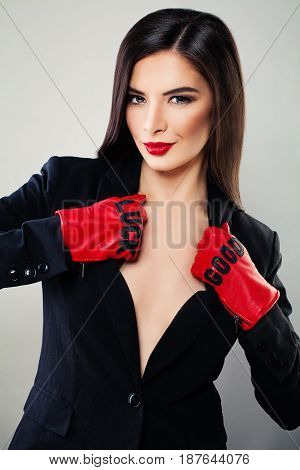 Glamorous Brunette Woman with Red Lips Makeup. Sensual Fashion Model