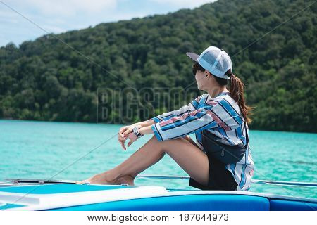 Side View. Asia Woman Sitting Alone On Prow And Looking Scenery Sea View With Green Forest On Island