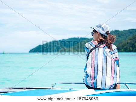 Back View. Asia Woman Sitting On Prow And Looking Scenery Sea View On Front Of Her. Have Island Are