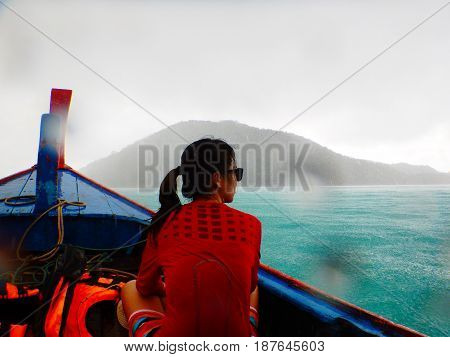 Asia Woman Wearing Red Shirt Sitting On Longtail Boat While Rainy Makes Herself Wet Moist. Have Sea