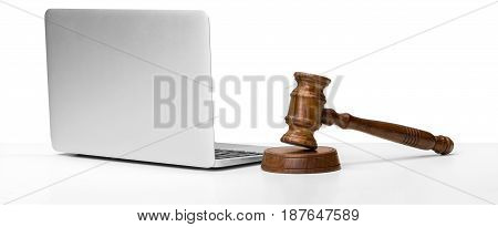 Laptop And Mallet On white Table .