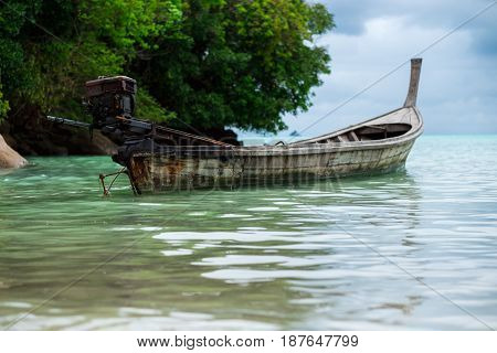 Longtail Boat Of Fisherman Parking On Shallow Sea. Have Sea And Mountain Are Background. This Image
