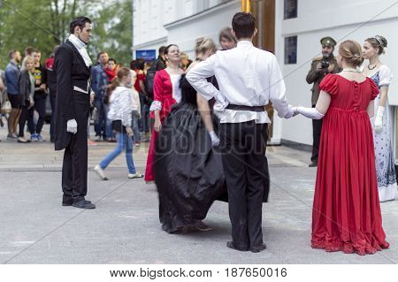 NIZHNY NOVGOROD, RUSSIA  May 20, 2017: Night of museums festival. Young girl and gentlemen dance padegra in the Russian Museum. NIZHNY NOVGOROD