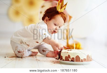 Curious Funny Baby Boy Poking Finger In His First Birthday Cake