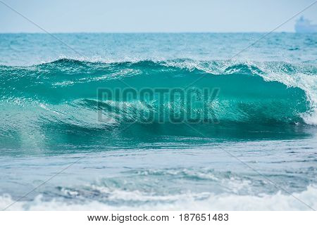 Wave barrel crashing and clear water. Blue wave in tropical ocean.