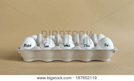 Monday To Friday Written On Eggs.