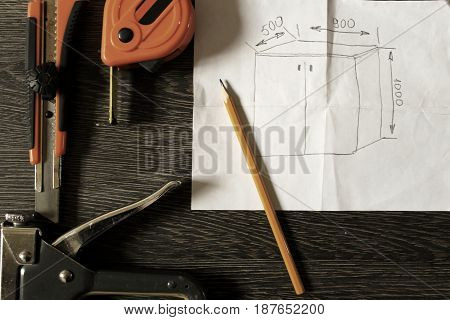 Tools and notebook on wood background. industry