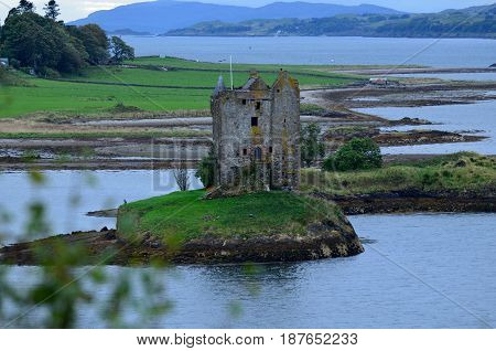 Scottish ruins of Castle Stalker on Loch Linnhe.