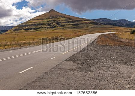 Asphalt Road Running Through Dry Orange Winter Mountain Landscape
