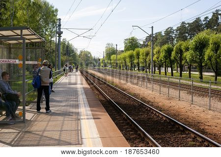 Jurmala, Latvia - May 20, 2017: People waiting for the train on the platform of railway station