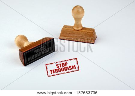 Stop terrorism. Rubber Stamper with Wooden handle Isolated on White Background.