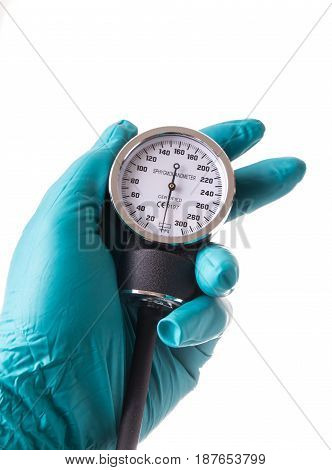 Hand with green protective glove holding an Blood pressure gauge isolated on white background
