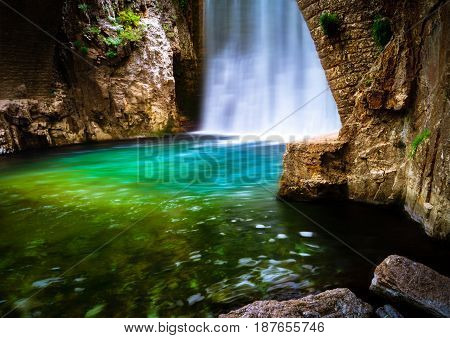 Waterfall.Natural hot spring bath surrounded by mountains