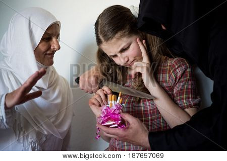 Teenager Looking At A Cigar And Considering Whether To Take Them From The Devil Who Holds The Knife