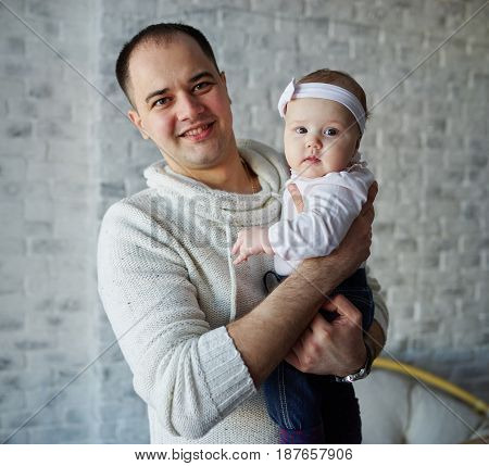 photo of happy father with cute baby