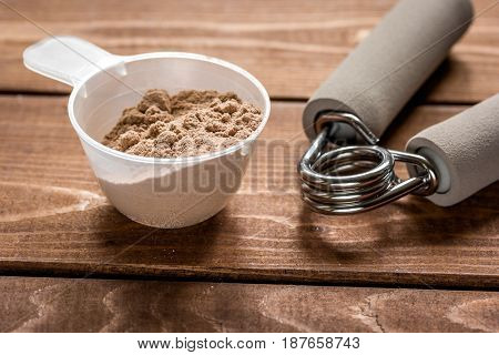 sport diet nutrition and fitness equipment , bars on wooden background