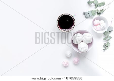 woman lunch with marsh-mallow and flowers trendy design in soft light on white table background flat lay mockup